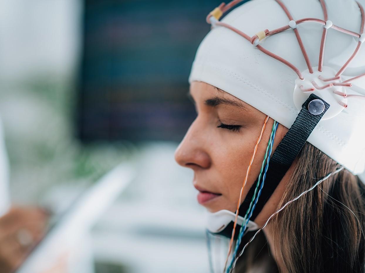 Woman having her brainwaves measured